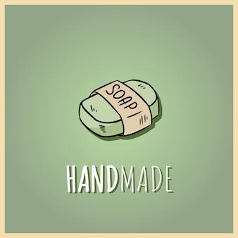 手作りの天然石鹸のロゴ。有機化粧品の手描きイラスト。