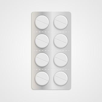 Белые реалистичные медицинские таблетки в блистерной упаковке.