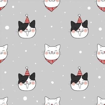 シームレスなパターンを描く冬の雪の中でかわいい猫
