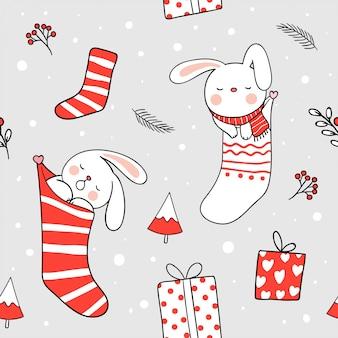 クリスマスの日のクリスマスソックスでシームレスな背景のウサギの睡眠