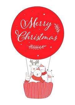 クリスマスのために赤い風船でかわいい動物を描く