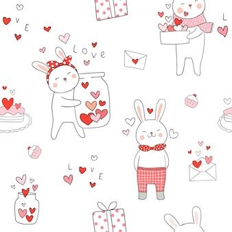 バレンタインの赤いハートとのシームレスなパターンのウサギ。
