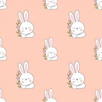 花とのシームレスなパターンのウサギ。