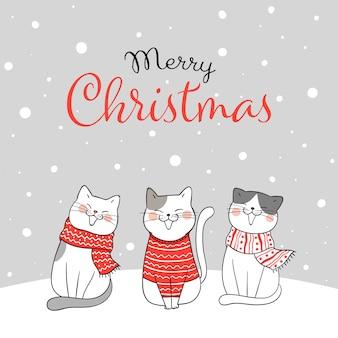 雪の中で座っている猫とメリークリスマスのグリーティングカード