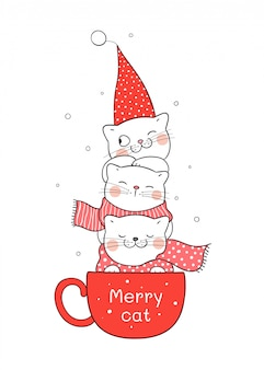 クリスマスと新年のために赤一杯のコーヒーで猫を描きます。
