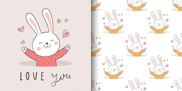 ファブリックテキスタイルの子供のためのグリーティングカードと印刷のシームレスパターンウサギ。