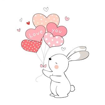 バレンタインデーにバルーンを保持しているウサギを描きます。