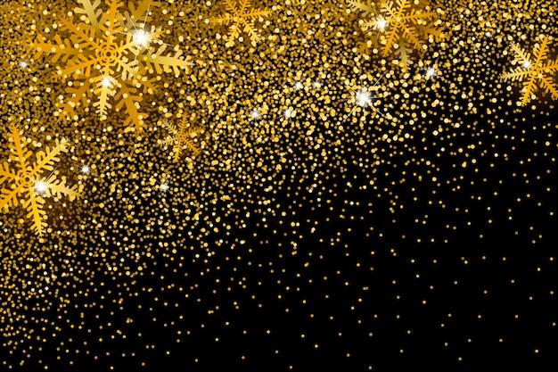 クリスマスのための金の輝きと雪片の背景