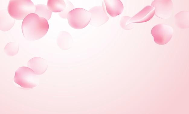 ピンクの背景に落ちるバラの花びら
