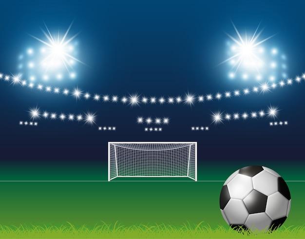 Футбольный мяч и цель с фоном на стадионе