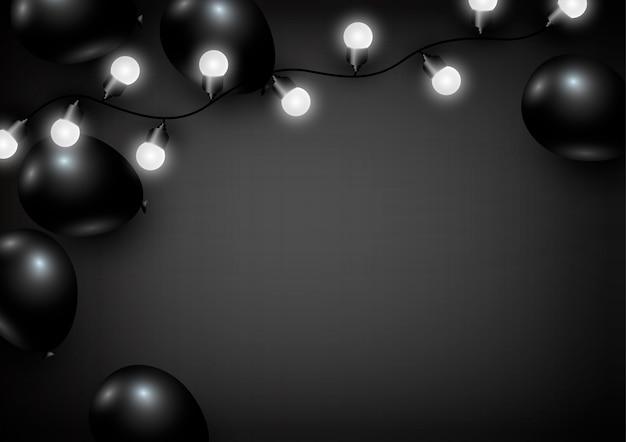Воздушный шар и лампочка на черном фоне