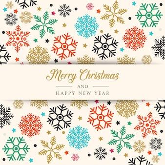 カラフルな雪片とクリスマスの背景