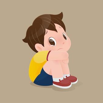 床に泣いて座っている男の子のイラスト。