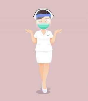 健康マスクまたはサージカルマスクと顔面シールドを身に着けている看護師