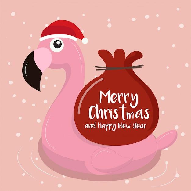 クリスマスの背景とスイミングリングフラミンゴ。