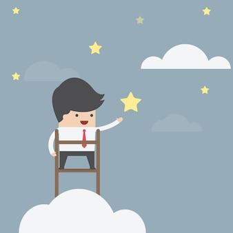 ビジネスマンは、星をキャッチしようとしている