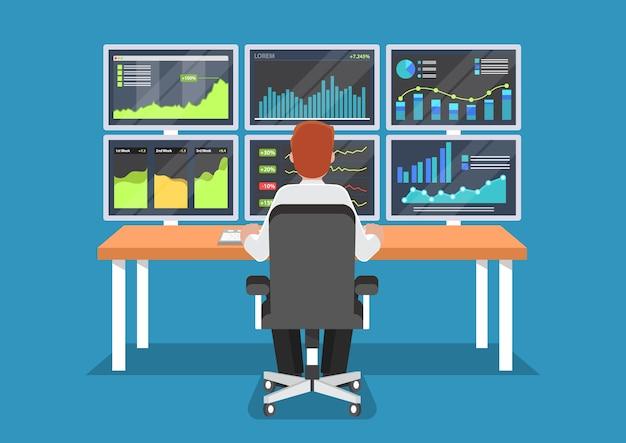 ビジネスマンまたは株式市場のトレーダーは、机で働いています。