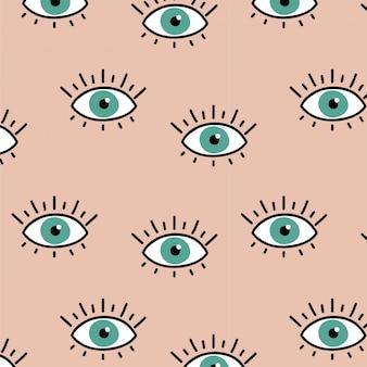 目のパターンとピンクの背景