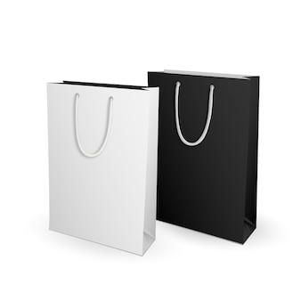 白と黒の空の広告やブランディングのためのテンプレートショッピングバッグをモックアップ