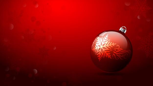 グリーティングカードの赤の背景にクリスマスボール