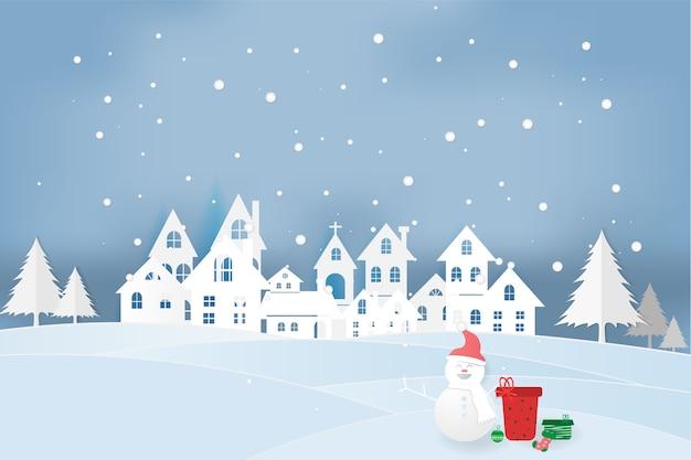 都市とクリスマスの雪だるまのペーパーアート