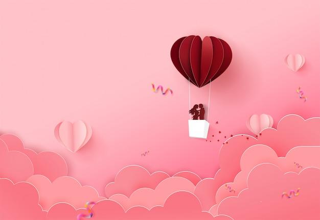 クラウド上の折り紙バルーンフロートとバレンタインデーの背景。
