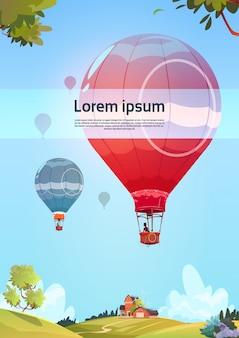 夏の風景の上空を飛んでいるカラフルな気球