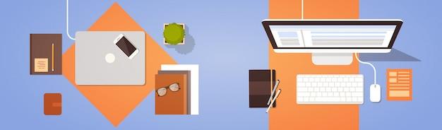 職場のデスクトップアングルビューラップトップとデスクトップコンピューター