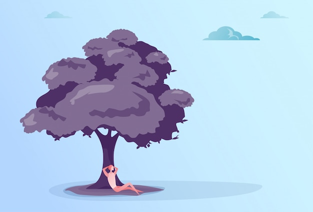 ビジネスの男性の木の下に座ってリラックスした実業家休暇休息のコンセプト