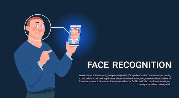 男ホールドスマートフォンスキャン顔認識コンセプトバイオメトリックアクセスコントロール技術