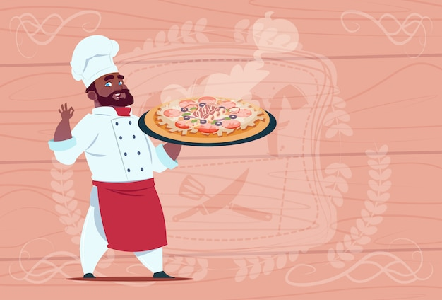 アフリカ系アメリカ人シェフクック持株ピザ笑顔漫画チーフホワイトレストラン制服木製テクスチャ背景の上