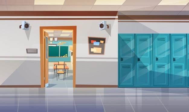 Пустой школьный коридор с раздевалкой. открытая дверь в классную комнату.