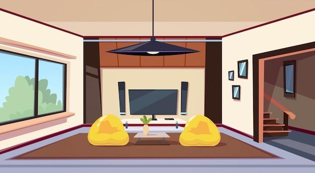 Современный интерьер гостиной с креслами-мешками и большим светодиодным телевизором на стене для домашнего кинотеатра
