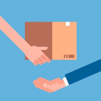 別の人に段ボールのパッケージを与える男の手。配送宅配便配送のコンセプト