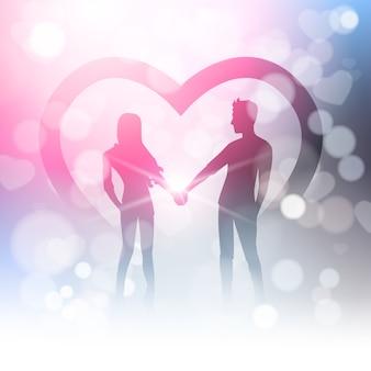 ぼやけている光沢のある光でカップルがボケ味とハートの形の上に手を握る