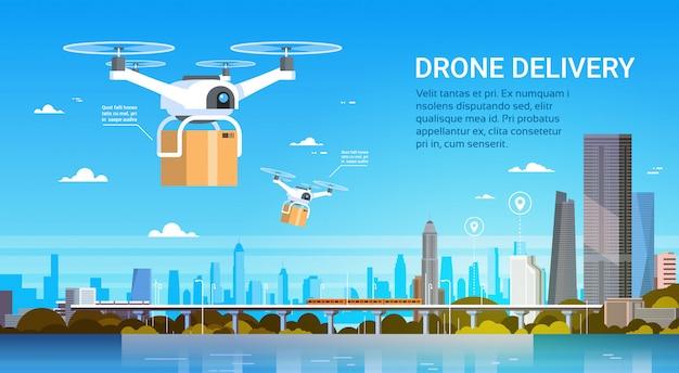ボックス付きドローンは近代的な都市、航空輸送配達概念の上空を飛ぶ