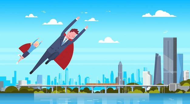 ビジネスの男性と女性の近代的な都市の上を飛んでレッドケープを着ているビジネスマンやビジネスウーマンのヒーロー