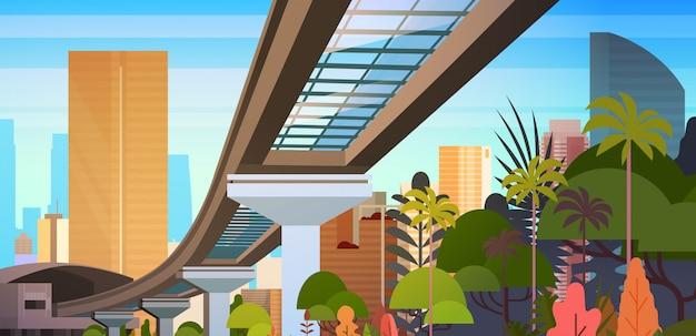 近代的な高層ビルや鉄道の道と街のスカイライン