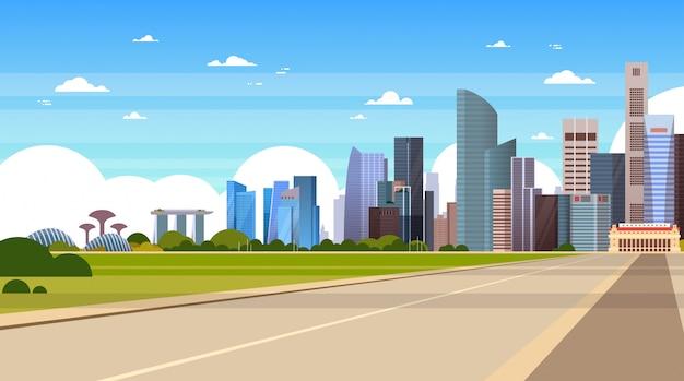 Дорога в современный городской пейзаж сингапура со знаменитыми достопримечательностями и сингапурскими небоскребами