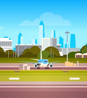 離陸前に滑走路に飛行機で空港ターミナル