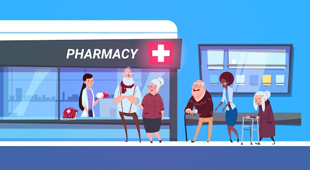 薬局に並んで立っている人々のグループ