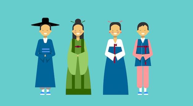アジアの人々が男性と女性の伝統的な衣装を着て