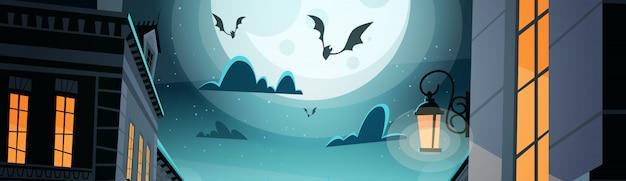 空にコウモリと夜の街ハッピーハロウィンパーティーのお祝いのコンセプト