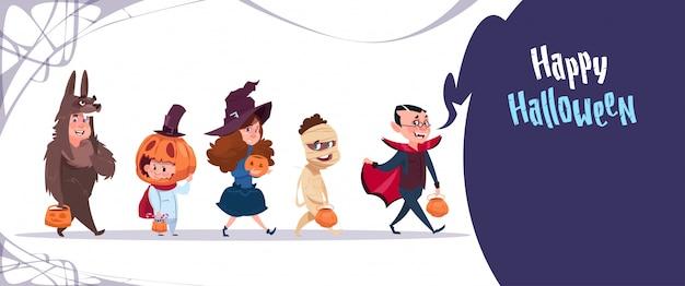 かわいい子供たちはモンスターコスチューム、幸せなハロウィーンバナーパーティーのお祝いの概念を着る