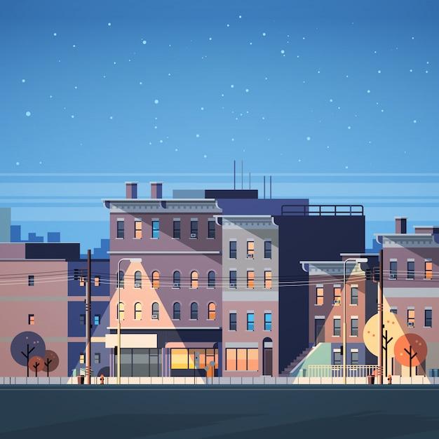 都市の建物の家の夜景のスカイラインの背景