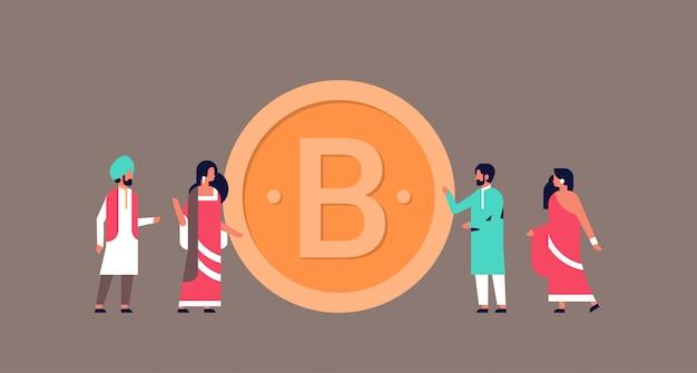 ビットコイン暗号通貨バナーをマイニングするインドのビジネス人々
