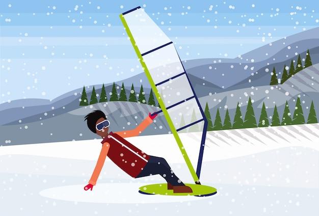 雪の中でウィンドサーフィンをする男
