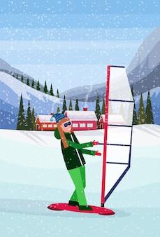 Женщина занимается виндсерфингом в снегу