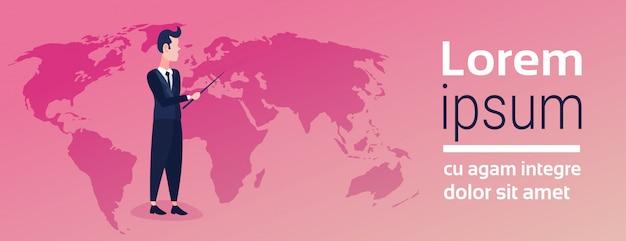 世界地図を指してビジネスマン