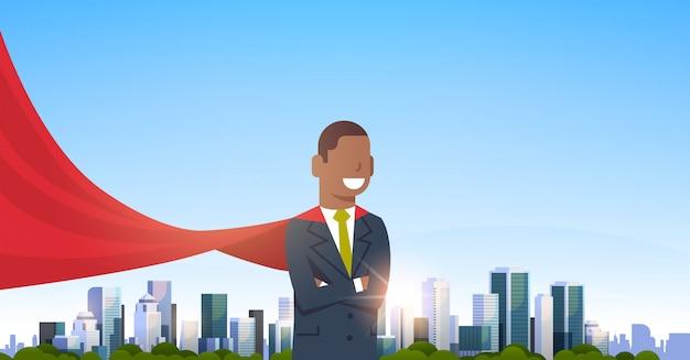 赤いスーパーヒーローを着ているアフリカ系アメリカ人の実業家